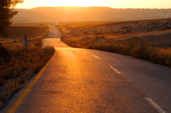Road at sunset Stock Image