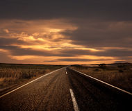 Road and The Sunset Stock Photos