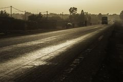 Road at sunset, Burkina Faso. A bright, shiny and contrasty road outside of Ouagadougou Burkina Faso, West Africa at sunset. Natural colors : not desaturated, no Stock Images