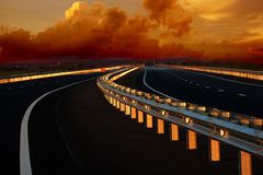 Road into the Sunset. High-speed highway in the sunset Stock Image