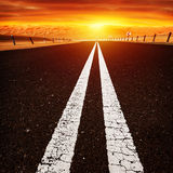 Road in sunset stock photography