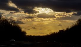 Road and the sunset sky. Shallow depth of road and the sunset sky freeway highway morning nature landscape travel asphalt horizon summer sunlight cloud sunrise stock photos