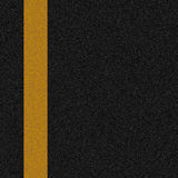 Road surface. Yellow line painted on asphalt road surface Stock Images