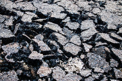 Road surface cracks. From the running of the car Stock Photos