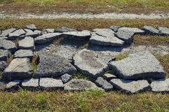 Road surface debris on the village road. Among green grass royalty free stock photos