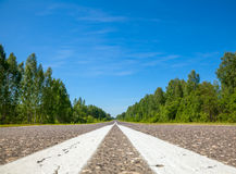 Road surface marking. Asphalt road with center lines marking close-up Royalty Free Stock Photo