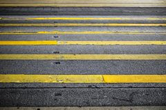 Road surface marking yellow lines Royalty Free Stock Photo