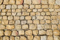 Road surface paved with cobblestone, Italy. Texture for design and background. Road surface paved with cobbleston, Italy, texture for design and background stock photo