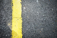 ROAD SURFACE WITH YELLOW CONTINUOUS LINE. Road surface with yellow line stock images