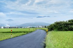 Road Surround by Green Grass Stock Images
