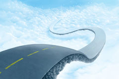 Road over the clouds. Road suspended in the sky over the clouds