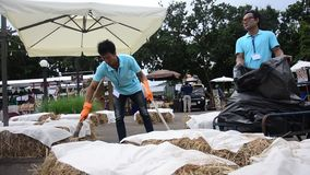 Road sweeper cleaning area before open activity at market fair. On November 29, 205 in Nakhon Ratchasima, Thailand stock video footage