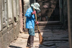 Road Sweeper cleaning walkway in ancient remains Royalty Free Stock Image