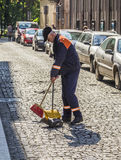 Road sweeper cleans the street in the morning Royalty Free Stock Photos