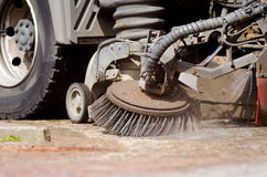 Road Sweeper. Detail of a road sweeper cleaning a market place Stock Photography