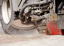 Road Sweeper. Detail of a road sweeper cleaning a market place Stock Photos