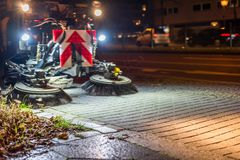 Road sweeper at night stock image
