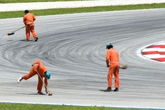 Road Sweepers. Doing their job before a racing event Stock Photography