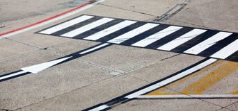 Road symbol on runway airport Royalty Free Stock Photos