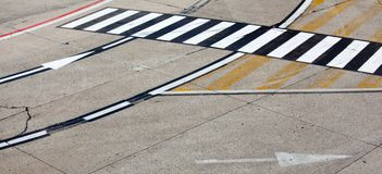Road symbol on runway airport Royalty Free Stock Images