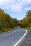 Road in taiga in autumn in Karelia Royalty Free Stock Photography