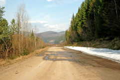 Road in Taiga, Deaf in Siberia. The old thrown road in a deaf Siberian taiga. A grait place to hunt Stock Images