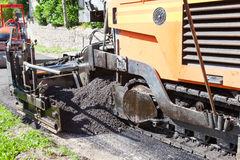 Road tarring machine using  a premix tar and gravel, compound Royalty Free Stock Images