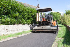 Road tarring machine in a village Stock Photos