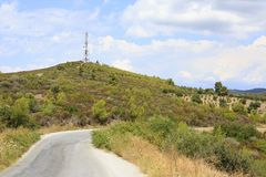 Road and television tower in the mountains. Royalty Free Stock Image
