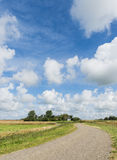 Road on Texel with Clouds Royalty Free Stock Photos
