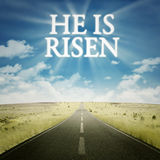 Road with text he is risen on the sky Royalty Free Stock Photography