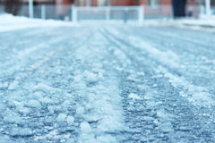 road after thaw and frost covered with slippery ice icy. Royalty Free Stock Image