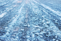 road after thaw and frost covered with slippery ice icy. Stock Image