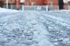 road after thaw and frost covered with slippery ice icy. Stock Photo