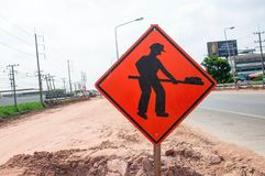 Under construction sign beside road stock photos