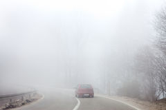 Road in thick fog Stock Photo