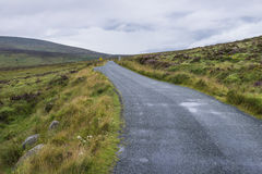 Road thorough the hills in Ireland Stock Images