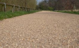 Road in the park, Birmingham 2019. A road is a thoroughfare, route, or way on land between two places that has been paved or otherwise improved to allow travel stock image
