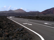 Road Through Lava Rocks And Volcanic Mountains Royalty Free Stock Photo