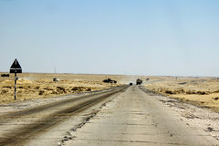 Road throuhg desert , Oman landscape. Concrete road through omani desert Royalty Free Stock Photography