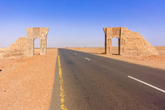 Road thru the Sahara desert in Sudan. Desert landscape and the road thru the Sahara desert in Sudan near Dongola in Sudan Stock Image