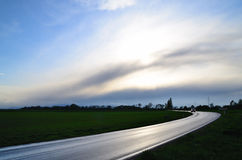Road after a thunderstorm. Road with car after a thunderstorm Stock Image