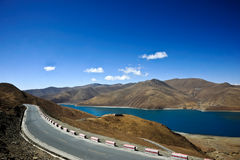 Road on the Tibetan lake Royalty Free Stock Photo