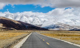 The road on the Tibetan Plateau Stock Images