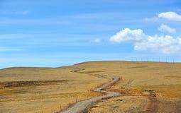 Road through the Tibetan plateau Stock Photo