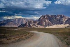 Road through the Tibetan plateau Royalty Free Stock Photo