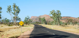 Road to Alice. Road the Alice Springs through the floodway royalty free stock image