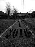 The Road to 2016. 2016 and an arrow pointing forward on an asphalt path Stock Photos