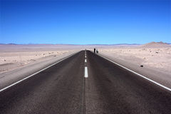 Road to Atacama. Lonely biker stopped to take a picture on the road to Atacama Royalty Free Stock Image