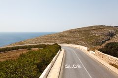 Road to Azure Window. Famous stone arch of Gozo island in the sun in summer, Malta Stock Photo